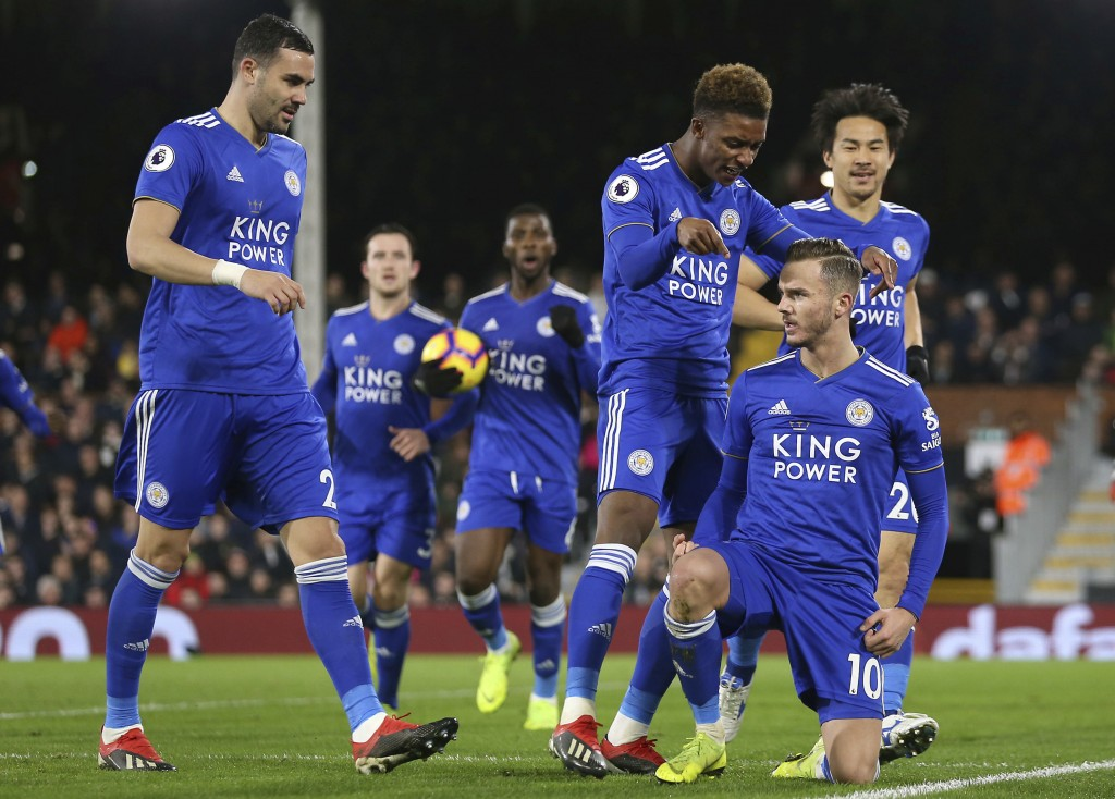 Leicester City's James Maddison, right, celebrates scoring his side's first goal of the game against Fulham during their English Premier League soccer