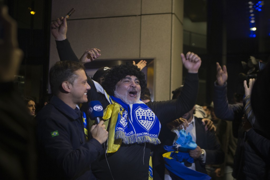 A Boca Juniors fan dressed as Maradona cheers outside the team's hotel in Madrid, Spain, Wednesday, Dec. 5, 2018. The Copa Libertadores Final will be
