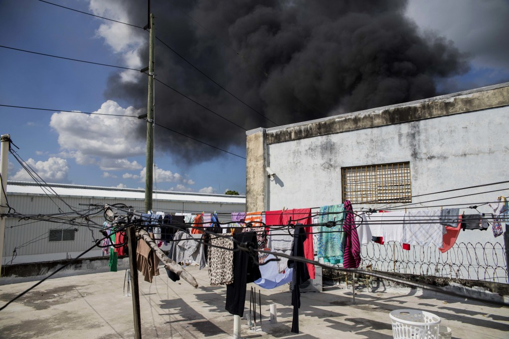 A black plume of smoke rises after an explosion at the Polyplas plant in the Villas Agricolas neighborhood in Santo Domingo, Dominican Republic, Wedne