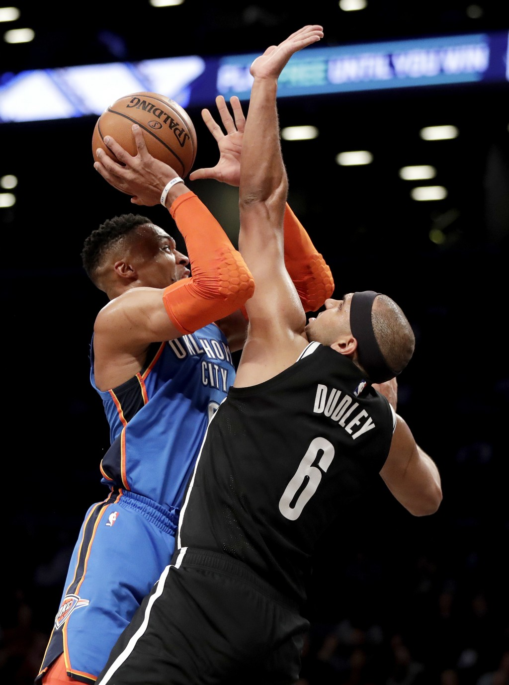 Oklahoma City Thunder guard Russell Westbrook, left, goes up for a shot against Brooklyn Nets forward Jared Dudley during the first half of an NBA bas