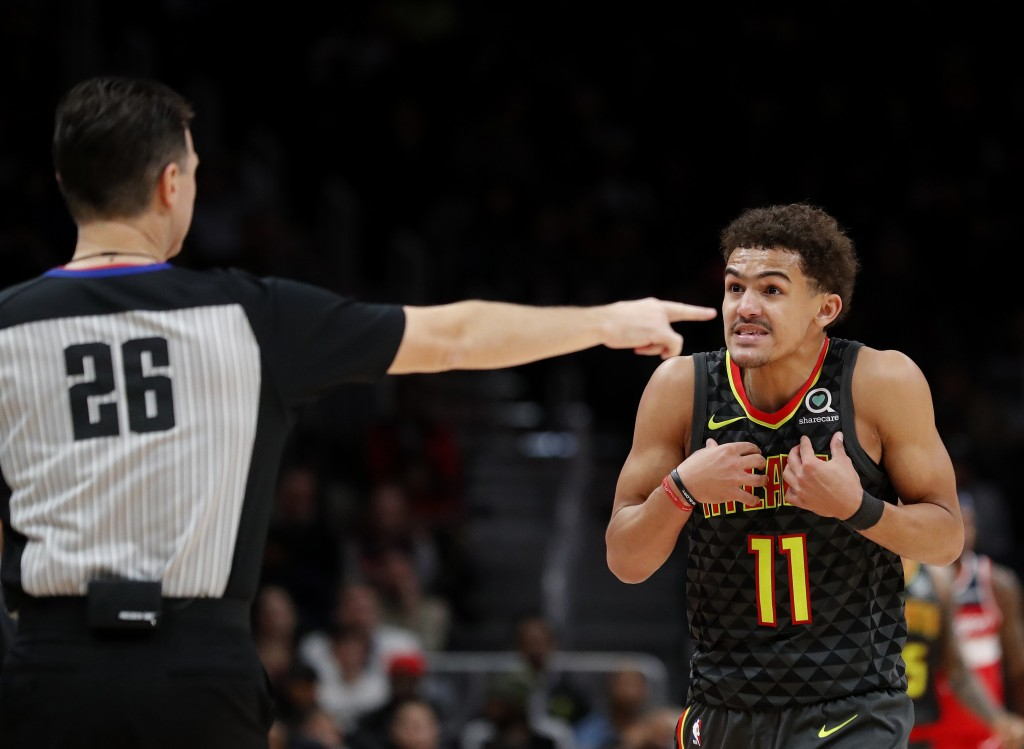 Atlanta Hawks guard Trae Young (11) reacts after a call during the second half of an NBA basketball game against the Washington Wizards Wednesday, Dec