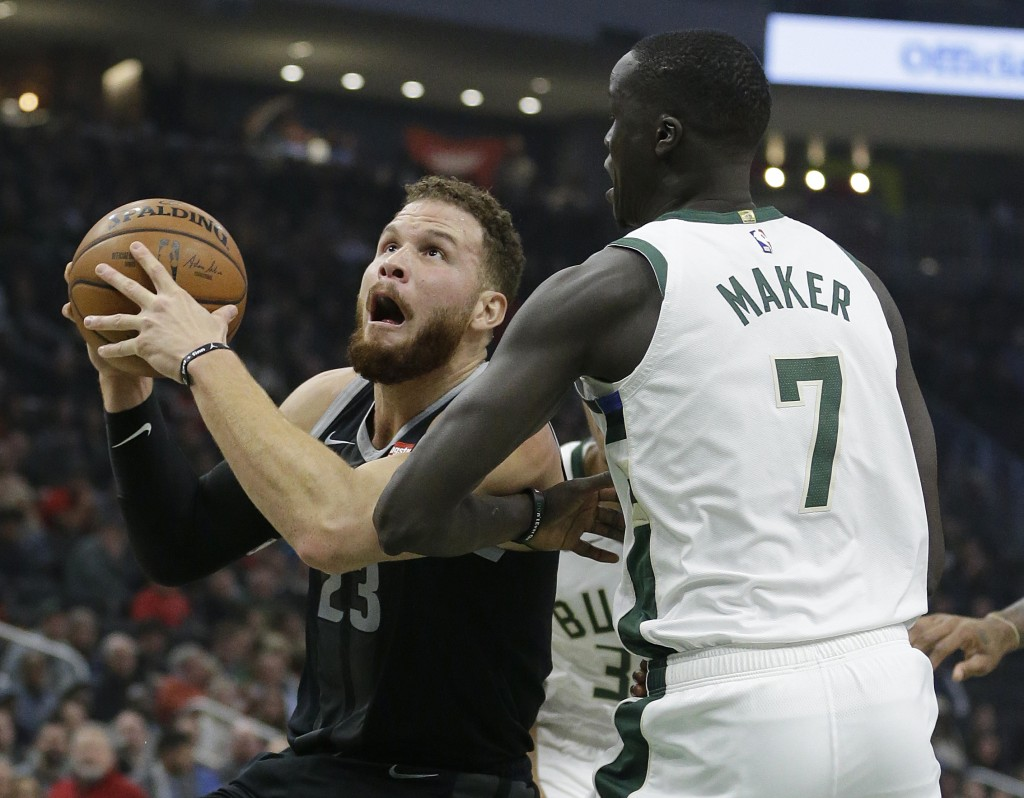 Detroit Pistons' Blake Griffin drives against Milwaukee Bucks' Thon Maker during the first half of an NBA basketball game Wednesday, Dec. 5, 2018, in