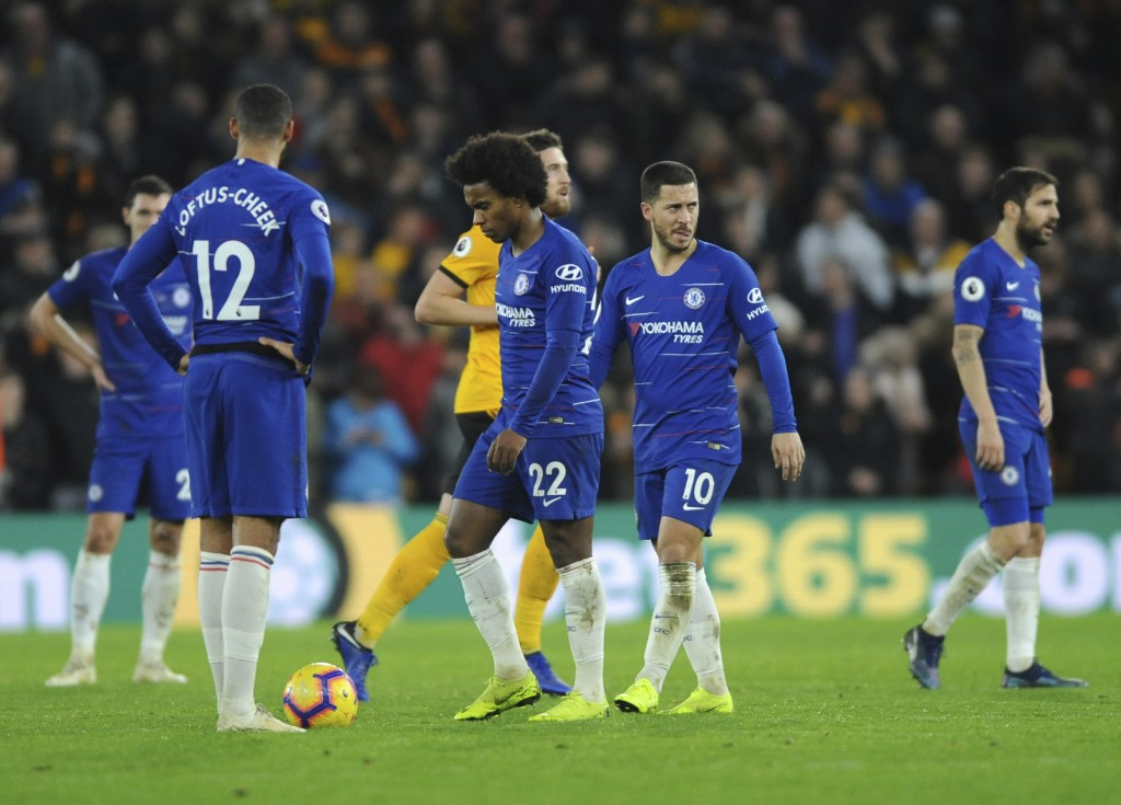 Chelsea's Eden Hazard, second right, reacts during the English Premier League soccer match between Wolverhampton Wanderers and Chelsea at the Molineux