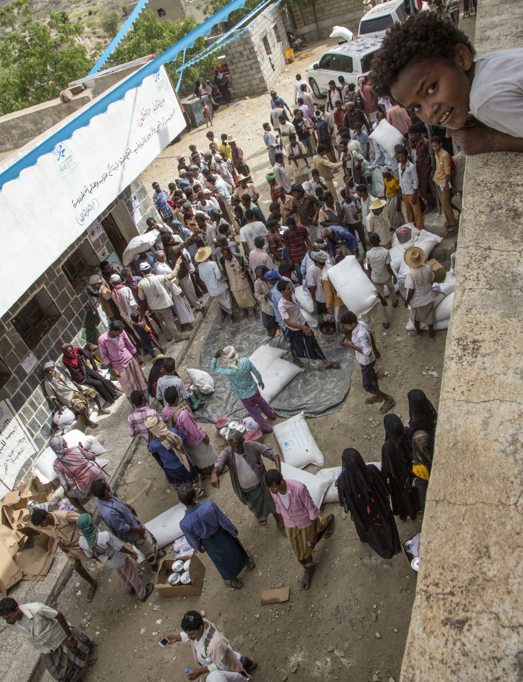 This Nov. 16, 2018 photo shows food distribution by the WFP in Aslem, Yemen. The U.N. food agency said Thursday, Dec. 6, 2018 it is planning to rapidl