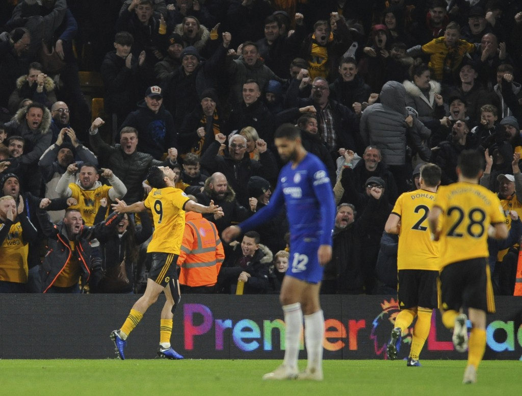Wolverhampton's Raul Jimenez, left, celebrates after scoring his side's opening goal during the English Premier League soccer match between Wolverhamp