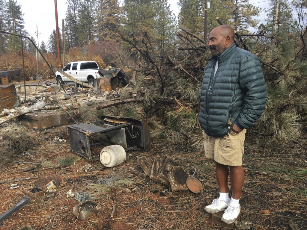 Resident Omar Franklin returns to his home destroyed by the Camp Fire in Paradise, Calif., Wednesday, Dec. 5, 2018. Hundreds of residents were finally