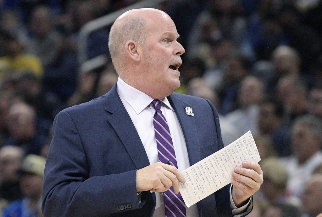 Orlando Magic head coach Steve Clifford calls out instructions during the first half of an NBA basketball game against the Denver Nuggets Wednesday, D