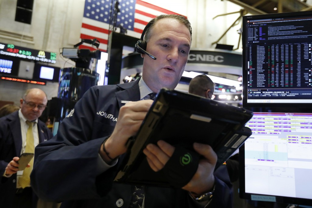 FILE- In this Nov. 28, 2018, file photo trader Jonathan Corpina works on the floor of the New York Stock Exchange. The U.S. stock market opens at 9:30