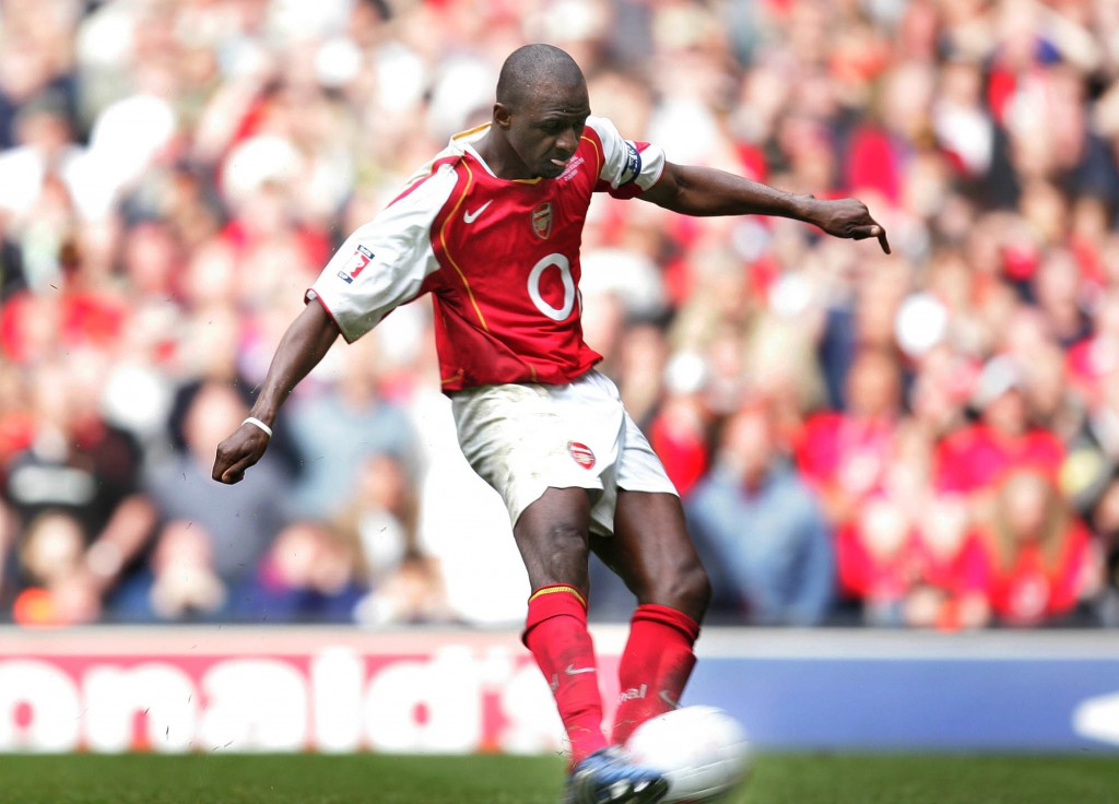 FILE - In this file photo dated  Saturday May 21, 2005, Arsenal's captain Patrick Vieira scores the winning penalty during a shootout at the end of th