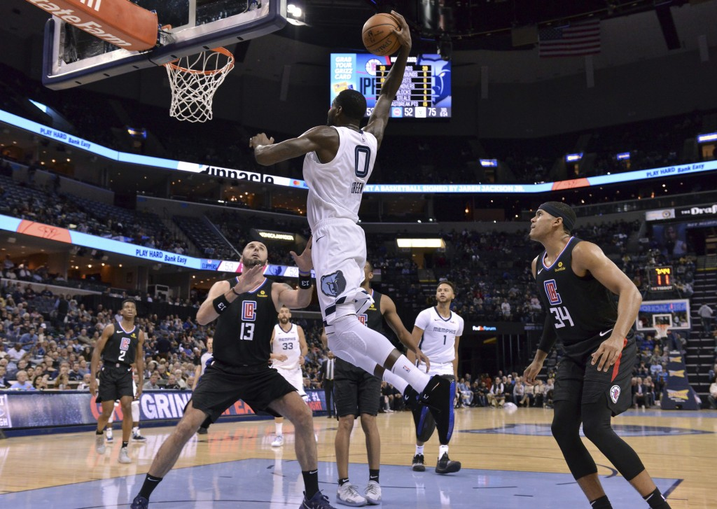 Memphis Grizzlies forward JaMychal Green (0) dunks the ball against Los Angeles Clippers center Marcin Gortat (13) in the second half of an NBA basket