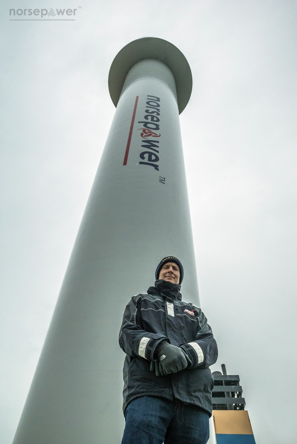 Tuomas Risk, CEO of Finnish startup company Norsepower, poses Nov. 2016, in the North Sea, in front of one of his company's rotor sails, one of the ne