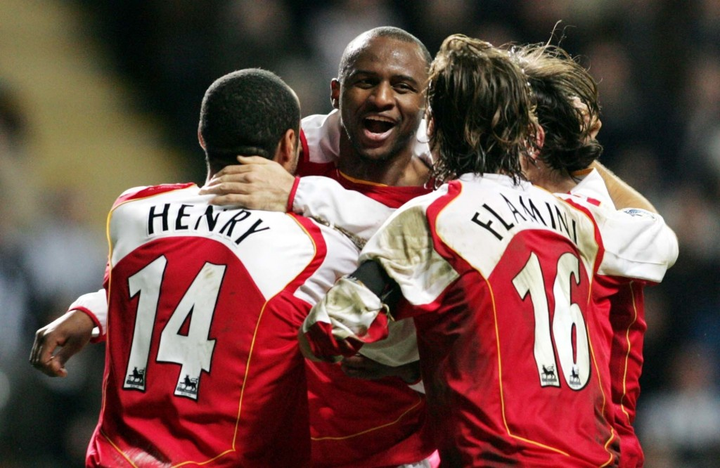 FILE - In this file photo dated Wednesday Dec. 29, 2004, Arsenal's Captain Patrick Veira, center, celebrates his goal with team mates Thieirry Henry,