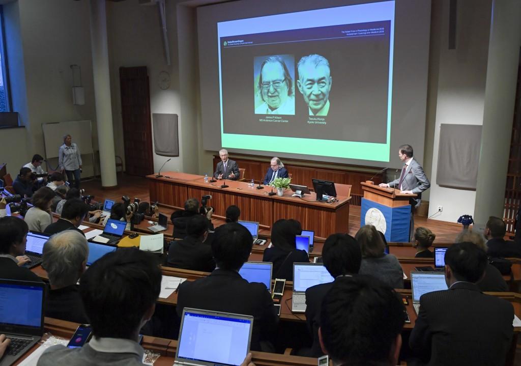 The 2018 Nobel laureates in Physiology or Medicine, Tasuko Honjo, left, and James P. Allison attend a press conference at the Karolinska Institutet, S