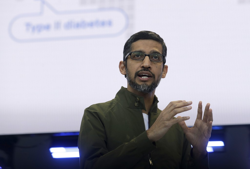 FILE - In this May 8, 2018, file photo, Google CEO Sundar Pichai speaks at the Google I/O conference in Mountain View, Calif. Top executives from Goog