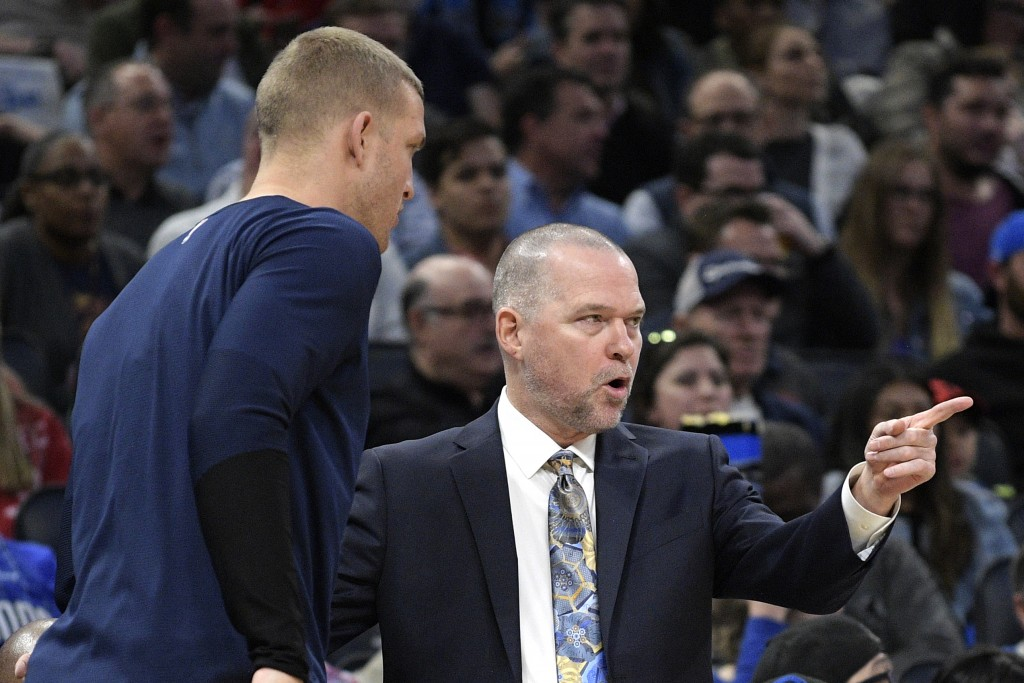 Denver Nuggets head coach Michael Malone, right, instructs forward Mason Plumlee as he comes off the bench during the first half of an NBA basketball