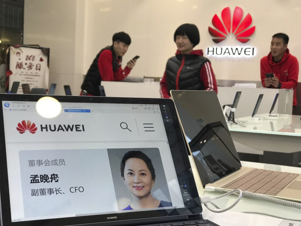 A profile of Huawei's chief financial officer Meng Wanzhou is displayed on a Huawei computer at a Huawei store in Beijing, China, Thursday, Dec. 6, 20