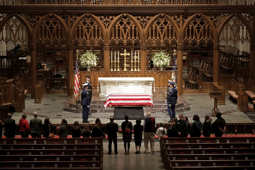 Visitors pay their respects to the flag-draped casket of former President George H.W. Bush at St. Martin's Episcopal Church, Wednesday, Dec. 5, 2018,