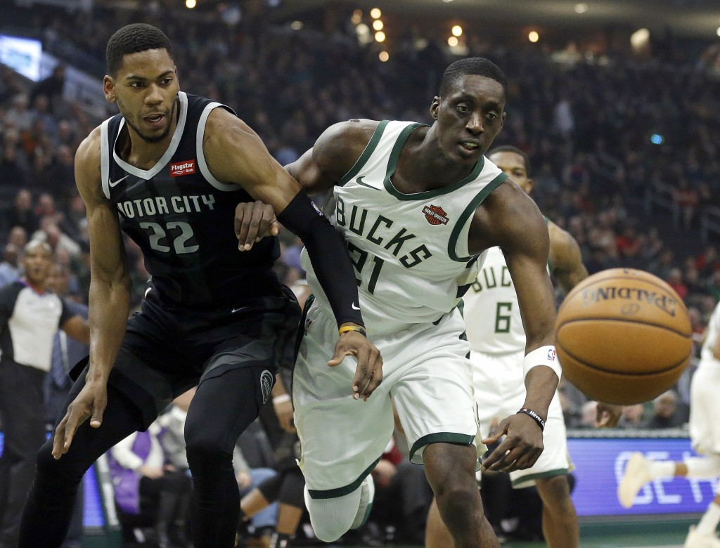 Detroit Pistons' Glenn Robinson III (22) and Milwaukee Bucks' Tony Snell fight for a rebound during the first half of an NBA basketball game Wednesday