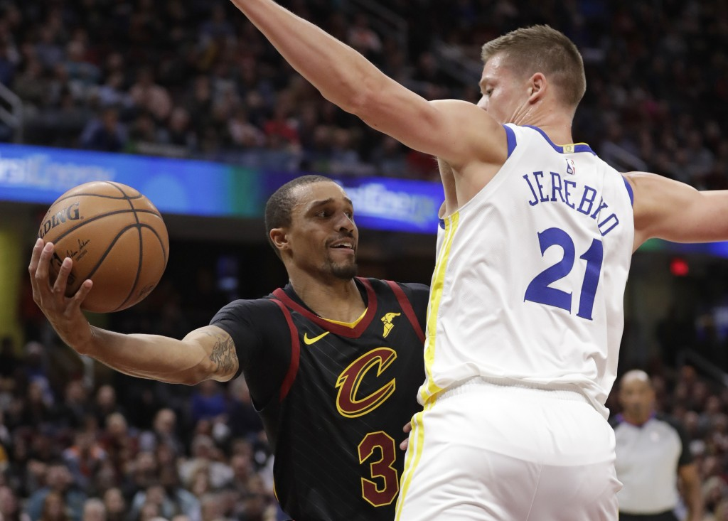 Cleveland Cavaliers' George Hill (3) looks to pass against Golden State Warriors' Jonas Jerebko (21), from Sweden, in the first half of an NBA basketb