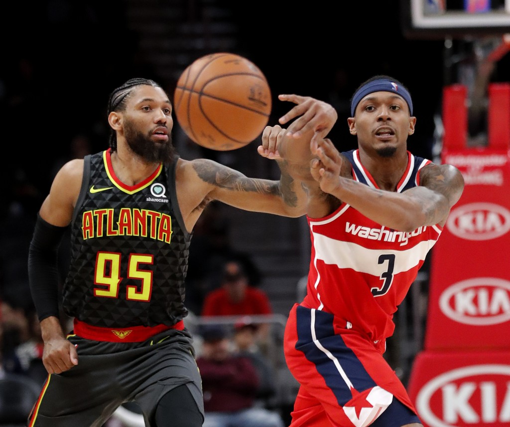 Washington Wizards guard Bradley Beal (3) passes as Atlanta Hawks forward DeAndre' Bembry (95) defends during the second half of an NBA basketball gam