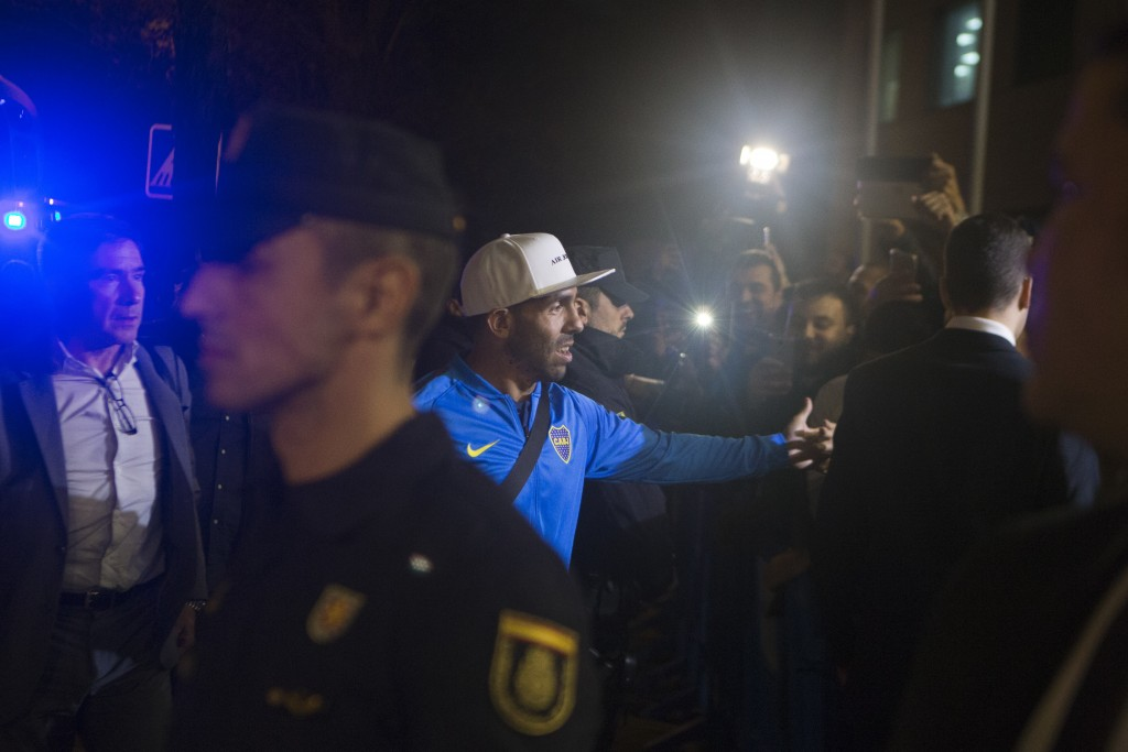 Boca Junior's Carlos Tevez, center, arrives with his team to their hotel in Madrid, Spain, Wednesday, Dec. 5, 2018. The Copa Libertadores Final will b