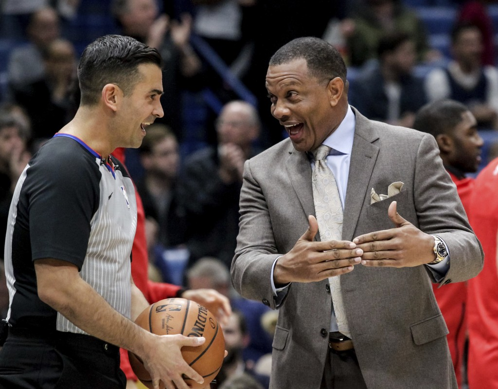 New Orleans Pelicans head coach Alvin Gentry discusses a call with referee Zach Zarba (15) in the first half of an NBA basketball game in New Orleans,