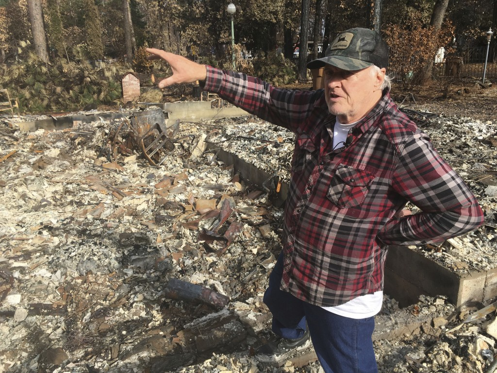 Returning resident Frank Windt checks his home that was burned in the Camp Fire in Paradise, Calif., Wednesday, Dec. 5, 2018. Hundreds of residents we