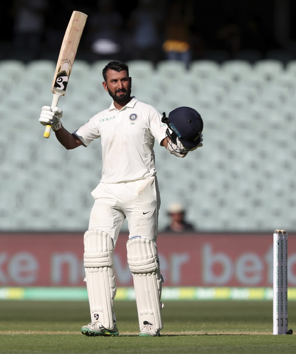 India's Cheteshwar Pujara celebrates after reaching a century during the first cricket test between Australia and India in Adelaide, Australia,Thursda