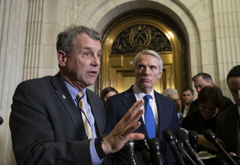 Sen. Sherrod Brown, D-Ohio, left, and Sen. Rob Portman, R-Ohio, speak to reporters after a meeting with General Motors CEO Mary Barra to discuss GM's