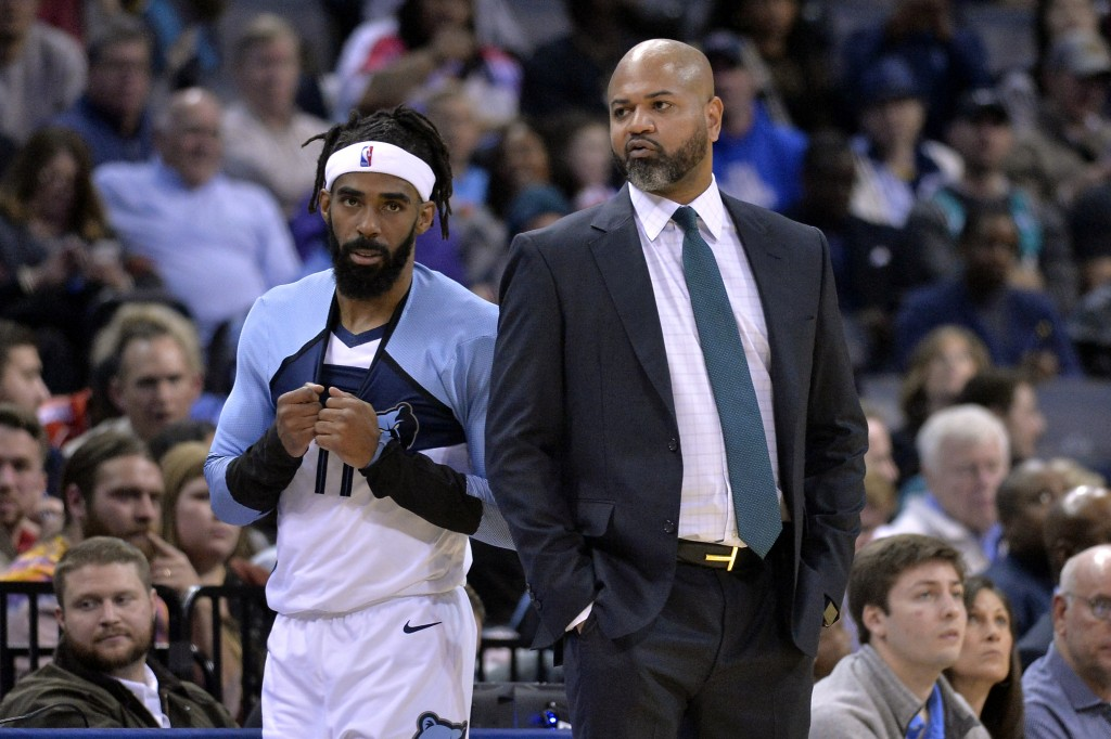 Memphis Grizzlies guard Mike Conley (11) talks with head coach J.B. Bickerstaff in the first half of an NBA basketball game against the Los Angeles Cl