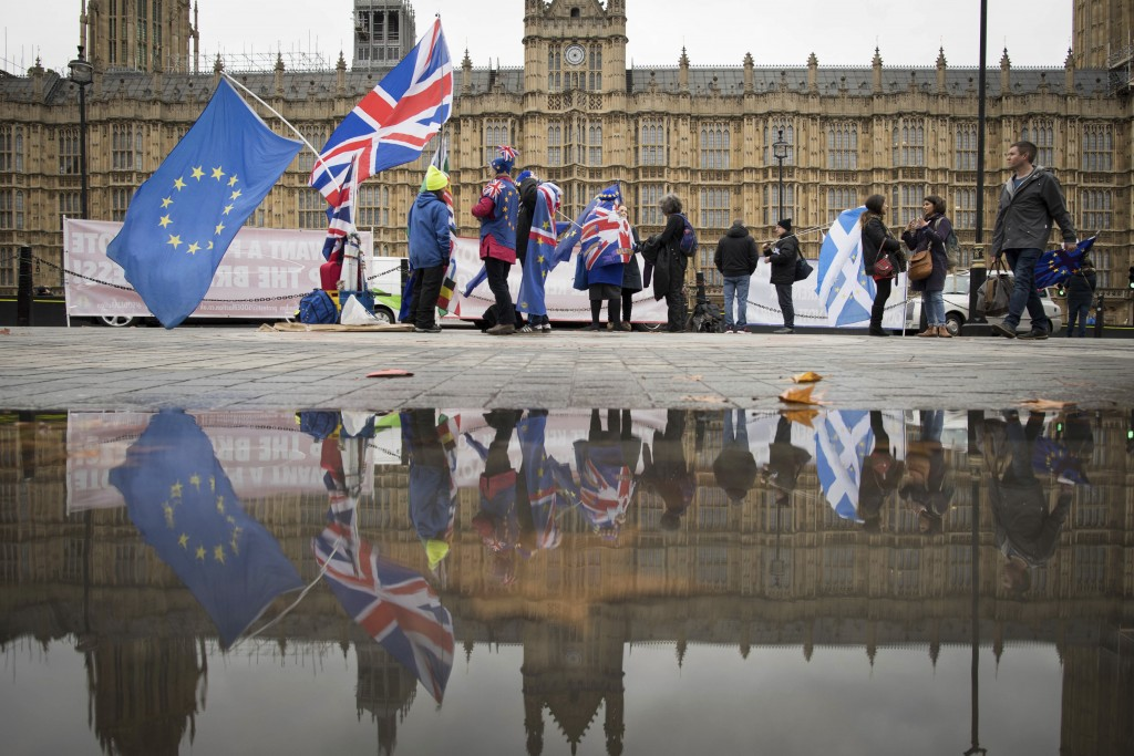 Anti Brexit demonstrators protest outside the Houses of Parliament in London Thursday Dec. 6, 2018.  Britain's Prime Minister Theresa May's effort to