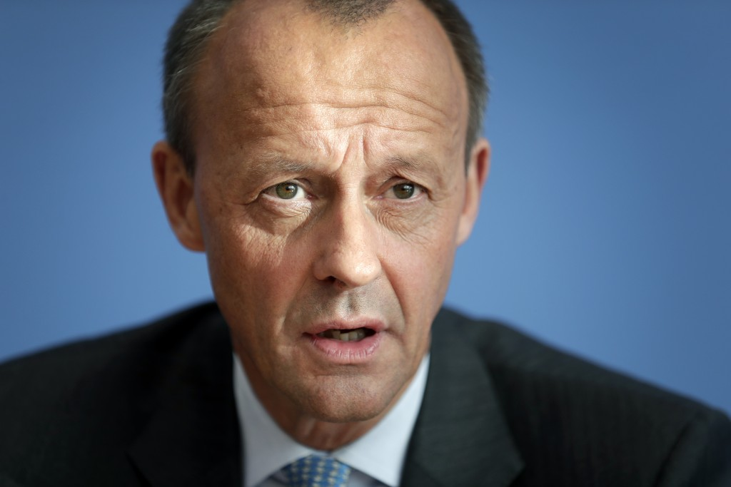 FILE - In this Wednesday, Oct. 31, 2018 file photo Friedrich Merz, member of the German Christian Democratic Party, addresses the media during a press