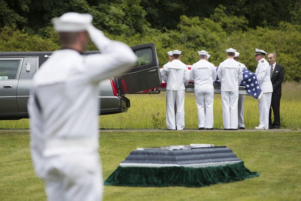FILE - In this June 9, 2018, file photo, a casket containing the remains of U.S. Navy Seaman 1st Class Edward Slapikas, a Newport Twp., Pa. native kil