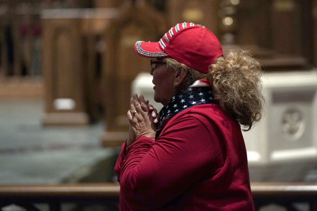 A woman waits to pay her respects as former President George H.W. Bush lies in repose at St. Martin's Episcopal Church Wednesday, Dec. 5, 2018, in Hou