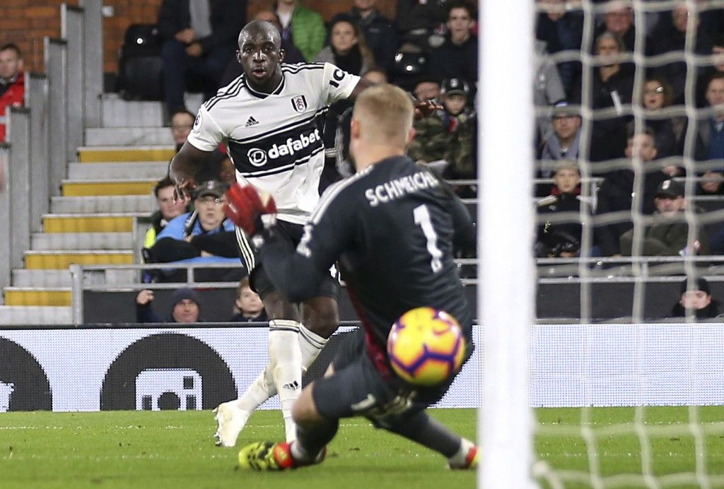 Fulham's Aboubakar Kamara, back, scores his side's first goal of the game against Leicester City during their English Premier League soccer match at C