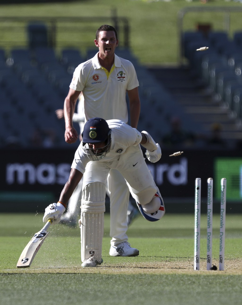 India's Cheteshwar Pujara is run out during the first cricket test between Australia and India in Adelaide, Australia,Thursday, Dec. 6, 2018. (AP Phot