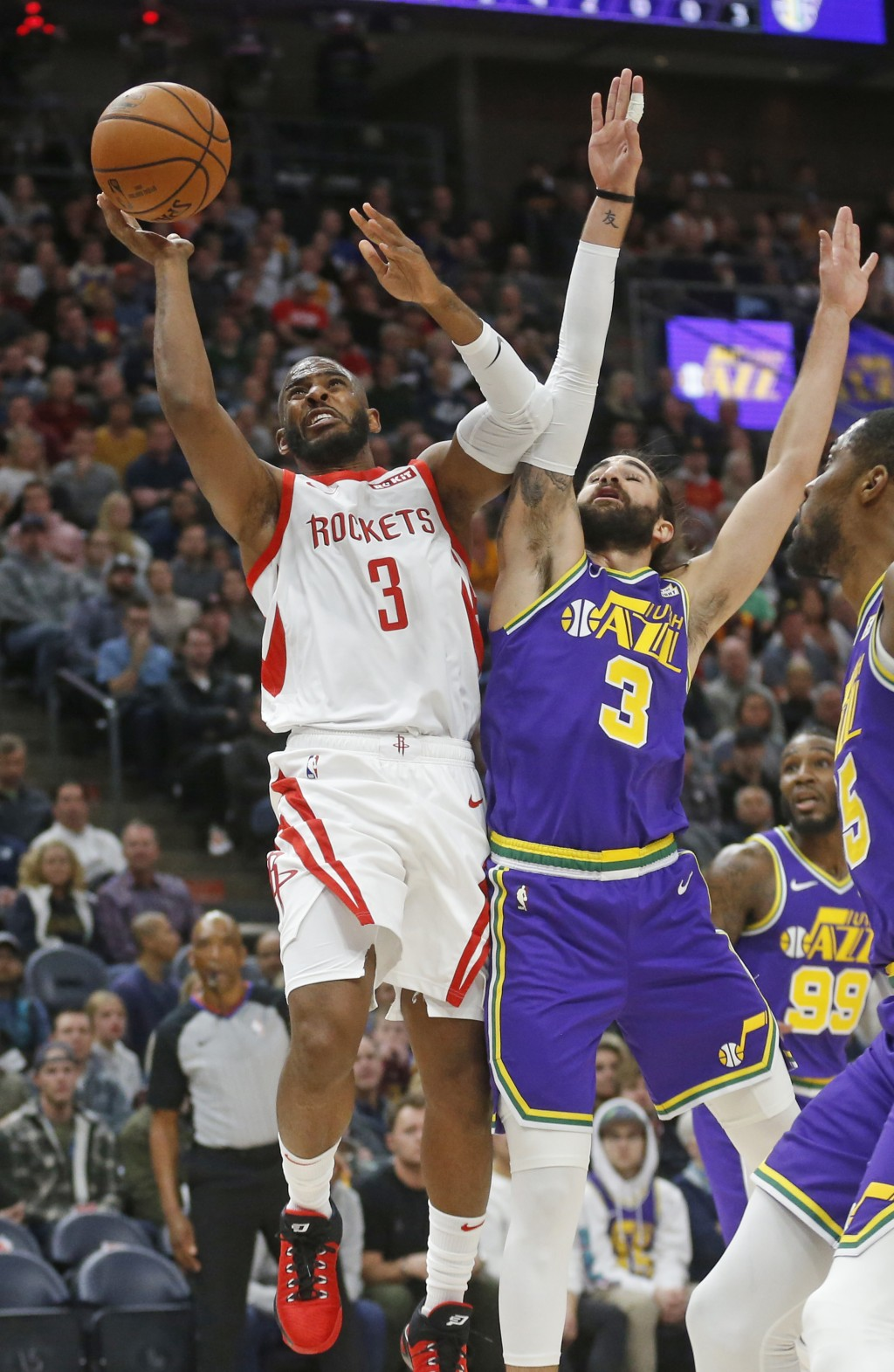 Houston Rockets guard Chris Paul (3) goes to the basket as Utah Jazz guard Ricky Rubio (3) defends in the first half during an NBA basketball game Thu