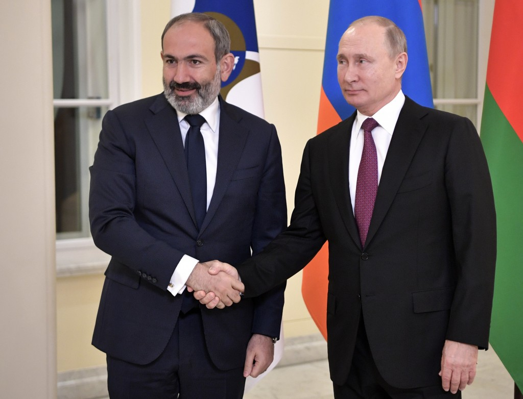 FILE In this file photo taken on Thursday, Dec. 6, 2018, Russian President Vladimir Putin, shakes hands with acting Armenian Prime Minister Nikol Pash
