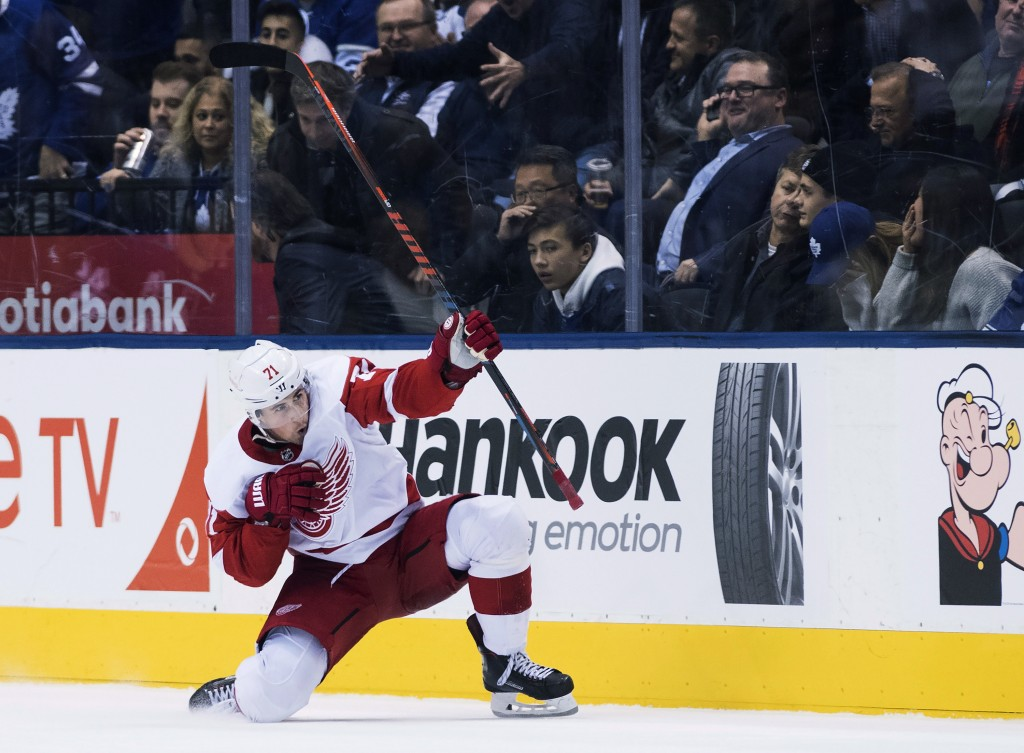 Detroit Red Wings center Dylan Larkin (71) reacts after scoring in overtime NHL against the Toronto Maple Leafs in Toronto on Thursday, Dec. 6, 2018.