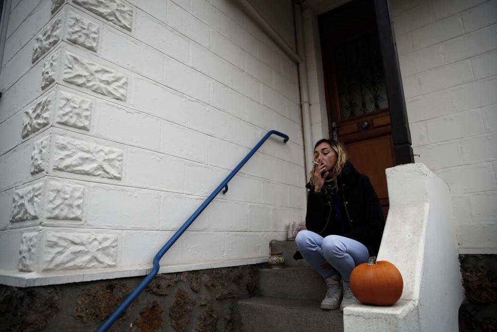 Mathilde Pouzet smokes a cigarette during an interview with Associated Press in Villeneuve-La-Garenne, outside Paris, Thursday, Dec. 6, 2018. Pouzet s