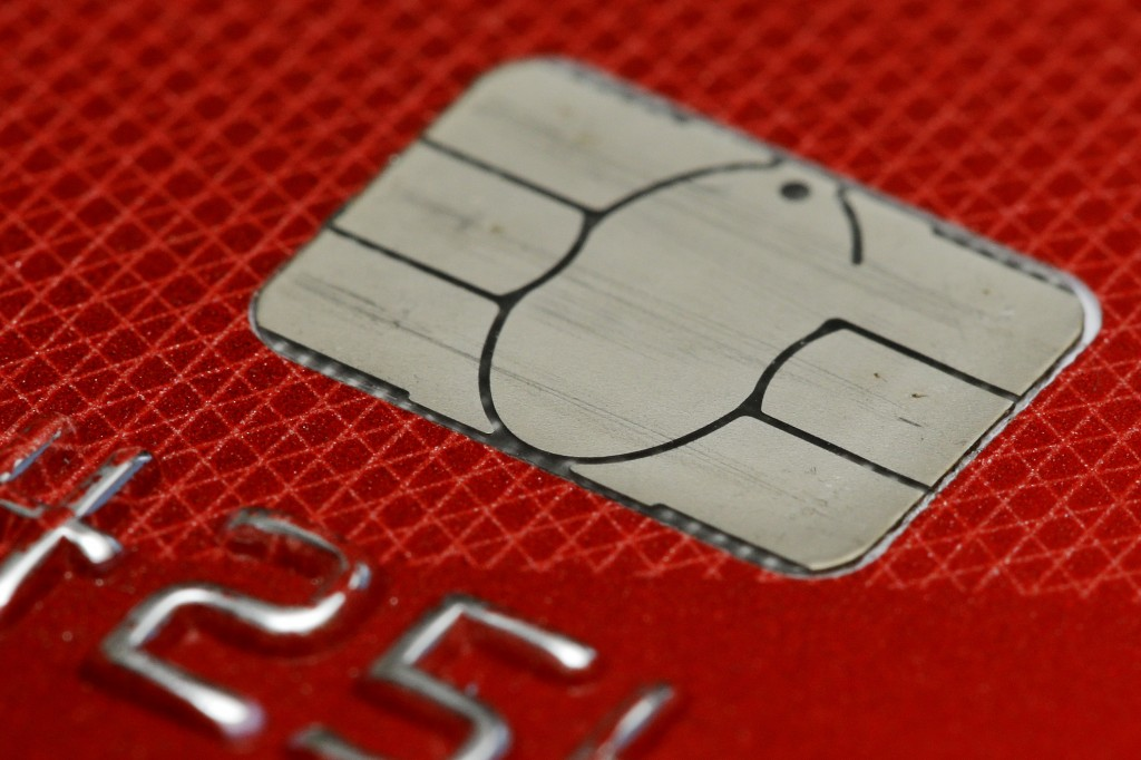 FILE- This June 10, 2015, file photo shows a chip credit card in Philadelphia. On Friday, Dec. 7, the Federal Reserve releases its October report on c
