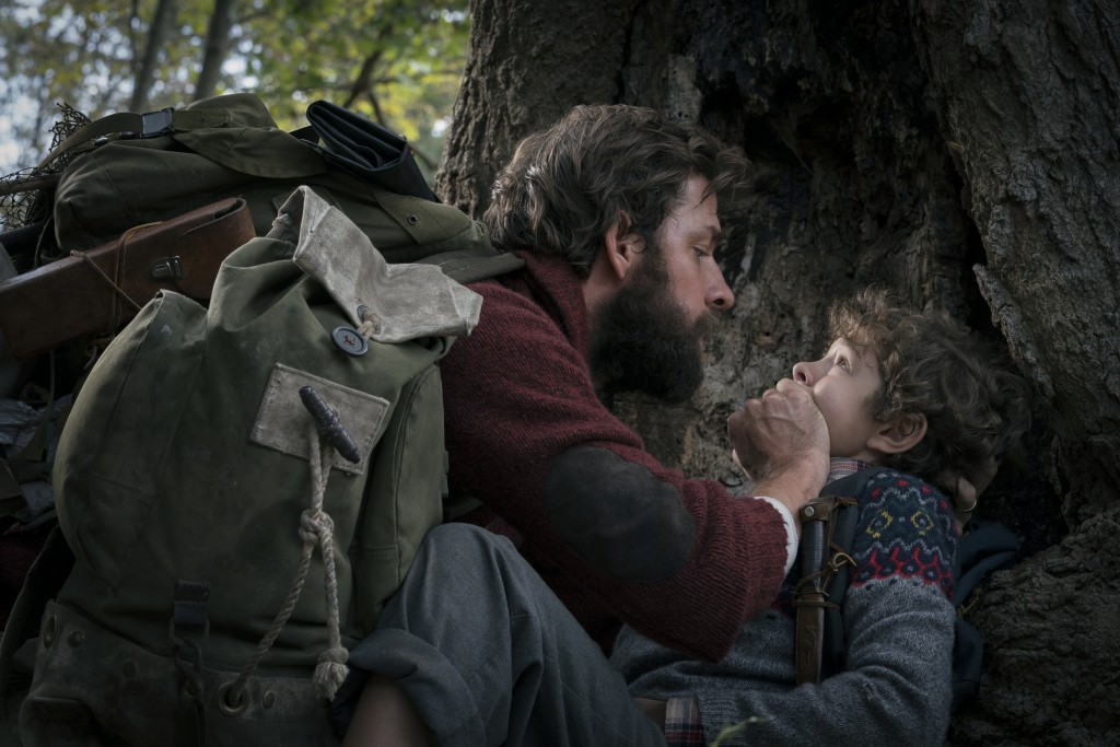 """This image released by Paramount Pictures shows John Krasinski, left, and Noah Jupe in a scene from """"A Quiet Place."""" Krasinski's celebrated mostly sil"""
