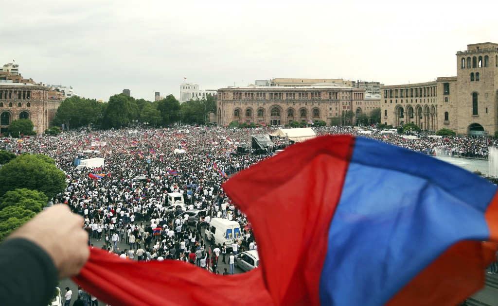 FILE - In this file photo taken on Tuesday, May 8, 2018, supporters of opposition lawmaker Nikol Pashinian gather in Republic Square in Yerevan, Armen
