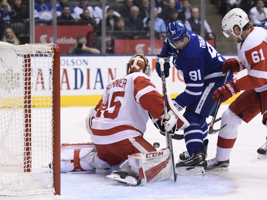 Toronto Maple Leafs center John Tavares (91) is stopped by Detroit Red Wings goaltender Jonathan Bernier (45) as Red Wings center Jacob de la Rose (61