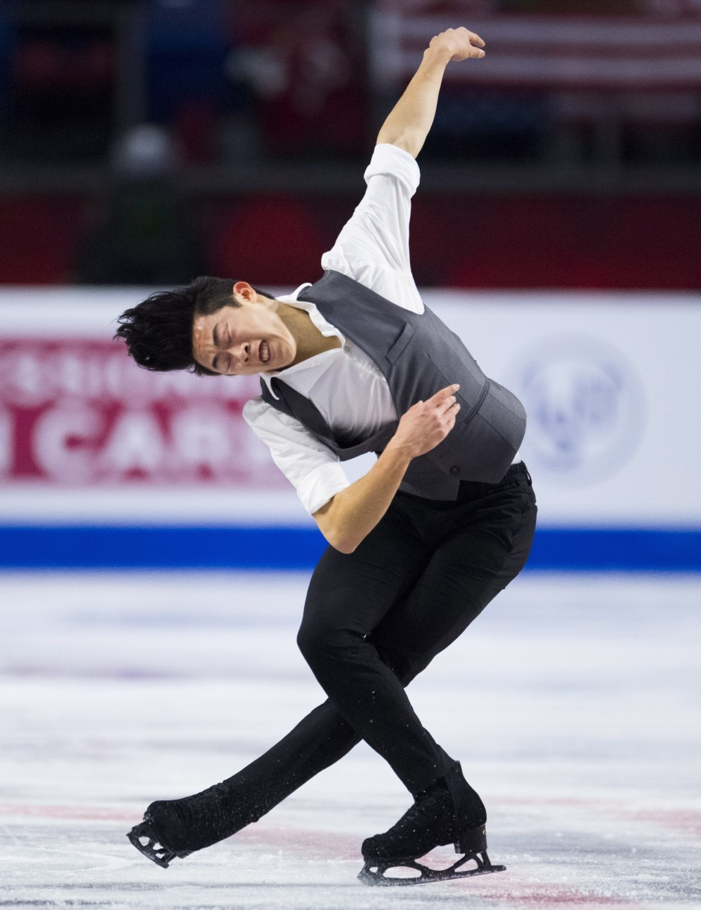 Nathan Chen, of the United States, performs during the men's short program at figure skating's Grand Prix Final in Vancouver, British Columbia, Thursd