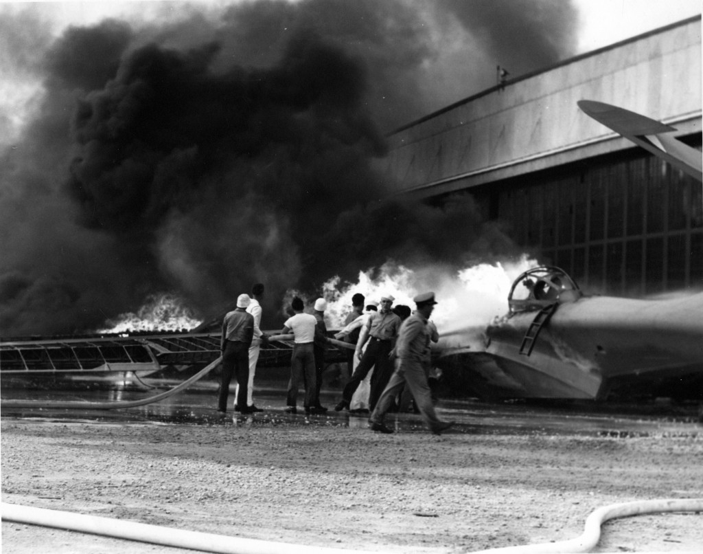 FILE - In this Dec. 7, 1941 file photo provided by the U.S. Navy, a patrol bomber burns at a military installation on Oahu's Kaneohe Bay during the Ja