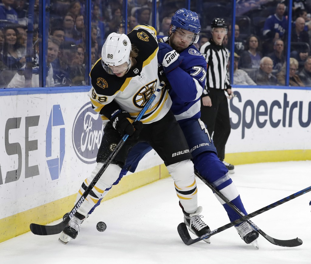 Tampa Bay Lightning defenseman Victor Hedman (77) knocks Boston Bruins right wing David Pastrnak (88) off the puck during the first period of an NHL h