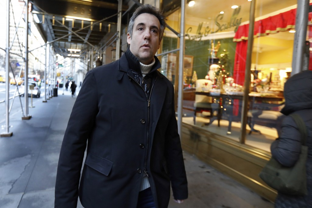 Michael Cohen, former lawyer to President Donald Trump, leaves his apartment building on New York's Park Avenue, Friday, Dec. 7, 2018. In the latest f