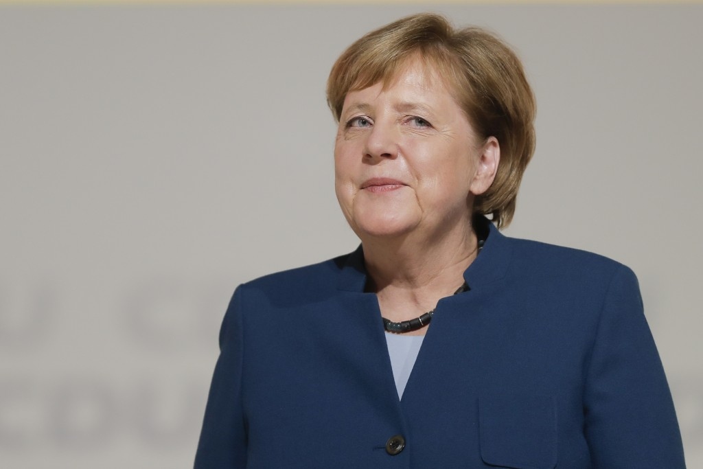 FILE - In this Dec. 7, 2018 file photo,  German Chancellor Angela Merkel receives the applause after her speech during a party convention of the Chris