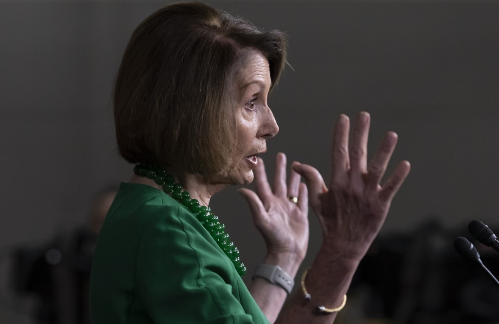 House Democratic Leader Nancy Pelosi of California, meets with reporters at her weekly news conference on Capitol Hill in Washington, Thursday, Dec. 6